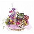 Basket of flowers and gourmet